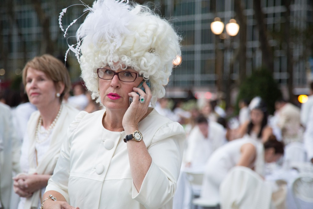 A guest with a wig at Diner en Blanc in Bryant Park on September 18, 2013.